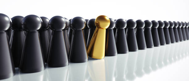 One golden game figure in a group of black figures on white background